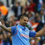 India's Shikhar Dhawan celebrates reaching his century